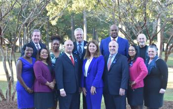 From left to right: Kim Butler Willis, Chris Kerrigan, Renee Linyard-Gary, Kellye McKenzie, R. Taylor Lee, Mark Dickson, Lorraine Lutton, Dr. Patrick Cawley, Anton Gunn, Amanda Lawrence, Paul Weiters, Tara Tsehlana